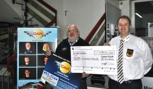 Car-Service-GM GmbH & CO. KG übergibt DLRG Gummersbach Scheck